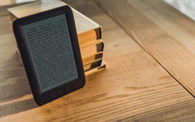 black-ebook-near-paper-books-on-wooden-table-6ML4VKJ